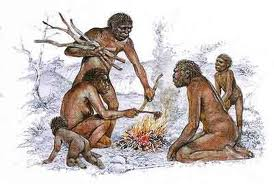 Homo Erectus Family With Fire